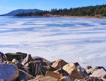 WINTER SNOW AND ICE COVERING BIG BEAR LAKE. This was a very cold winter's day in Big Bear Lake, California. The white snow and ice on the lake looked like clouds royalty free stock image