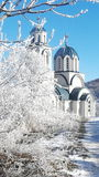 Winter. Snow, ice, sunlight, church stock photography