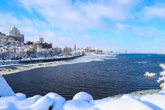 Winter snow landscape of the Dnipro city. View of the buildings, skyscrapers, Dnieper river. towers, Ukraine, Dnepropetrovsk. Winter snow landscape of the Dnipro royalty free stock images
