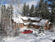 Winter snow on large modern home Stock Image