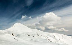Winter snow on mount Sodadura. Winter in Italian Alps on mount Sodadura with snow and clouds Stock Photography