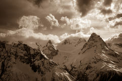 Winter snow mountains in clouds Stock Photography