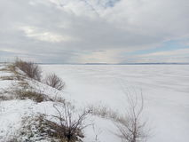 Winter, snow, overcast,River under the ice, ice fishing, sky clouds, white horizon,white steppe stock image
