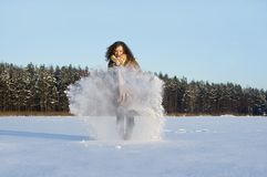 In winter the snow plays a curly-haired girl Royalty Free Stock Photos