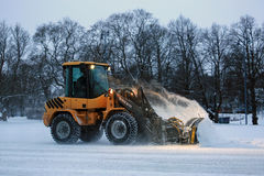 Winter Snow Removal in the Evening Royalty Free Stock Photos