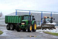 Winter Snow Removal with John Deere and Valtra Tractors Stock Photos