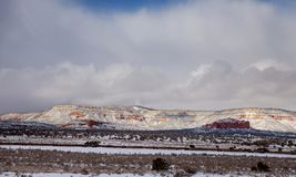 A winter snow on the road to park in southwest New Mexico. Desert winter stock photo