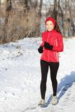 Winter snow runner woman Royalty Free Stock Photography