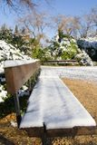 Winter snow scene. Snow covered bench Royalty Free Stock Photos