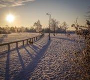 Winter snow scene park season. Snow covered park scene winter season low light Royalty Free Stock Photography
