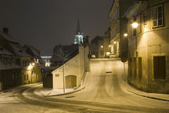 Winter snow street in Sibiu by night Royalty Free Stock Photo