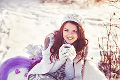 Winter, snow, sunny day and cup of tea in hand Royalty Free Stock Photos