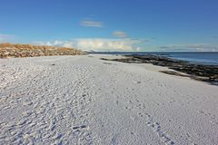 Winter snow on Dornoch Beach Stock Image