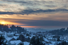 Winter Snow at Sunset in Happy Valley Oregon. Happy Valley Oregon suburban neighborhood homes covered in snow during sunset stock images
