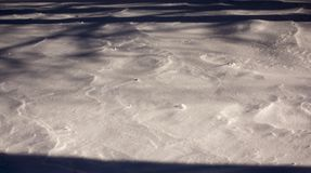 Snow and wind combined formed snow waves in a agricultural environment stock image