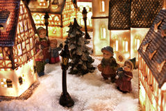 Winter snow town. Christmas tree miniature wonderland with kids and houses in holiday spirit Stock Photo