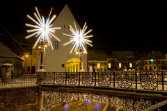 Winter snow town square christmas lights Sibiu. Winter snow christmas lights on street and bridge in Sibiu in winter long exposure image by night with public Royalty Free Stock Photos