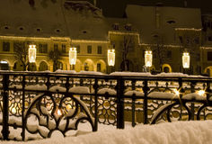 Winter snow town square houses christmas. New year decoration public lighting fairy like atmosphere Sibiu Transylvania Stock Photos