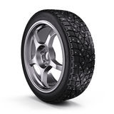 Winter snow tyre with metal spikes  on white background Stock Photo