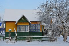 Winter snow vacation home. In the village Royalty Free Stock Image