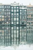 Winter snow view of Dutch canal houses in Amsterdam royalty free stock photography