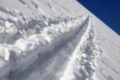 Winter - snow way and blue sky Stock Photos