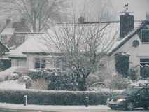 Winter snow winterwonderland. Cute little house in snow in the winter Royalty Free Stock Photos