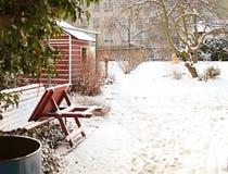 Winter snowed in garden Stock Images