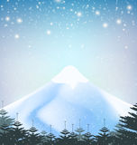 Winter snowfall drop mountain on blue background Stock Photo