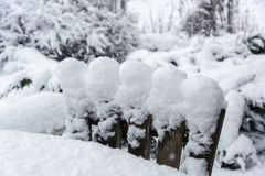 Winter, snowfall in the garden. Table and chairs with snow. Winter, snowfall in the garden. Table and chairs covered with snow stock photography