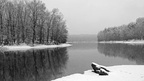 Winter snowfall scene by the water Royalty Free Stock Photography