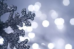 Winter Snowflake. Frozen ice snowflake with soft christmas lights Stock Photo