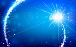 Winter snowflake falling with glittering and lighting over blue. Winter snowflake falling into snow floor and lighting over blue abstract background for winter Royalty Free Stock Photo