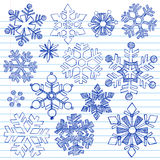 Winter Snowflakes Hand-Drawn Sketchy Doodles. Hand-Drawn Winter Holiday Snowflakes Sketchy Notebook Doodles. Vector Illustration Design Elements on Lined Paper Stock Images