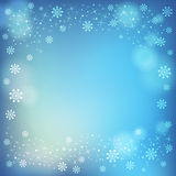 Winter snowflakes and soft highlights background. Royalty Free Stock Photography