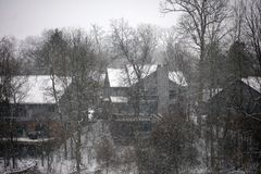 Winter snowing scene with houses and trees in background Royalty Free Stock Photography