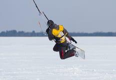 Winter Snowkiting. Man winter snowkiting on a frozen lake Stock Image