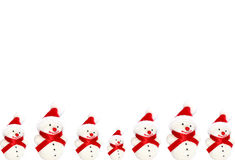 Winter Snowmen. Isolated snowmen over white stock photography