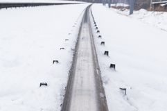 Winter and snow on the railroad tracks in winter. Close-up royalty free stock photo