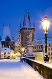 Wintertime Charles bridge, gothic Lesser Town bridge tower, Less. Winter snowy Charles bridge, gothic Lesser Town bridge tower, Lesser town district, Prague royalty free stock photo