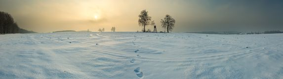 Winter snowy fields with raised hide and foggy day. Winter snowy fields and foggy day. Beautiful european winter landscape with raised hide Royalty Free Stock Image