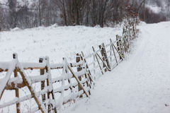 Winter snowy landscape. Winter landscape of a fence in the transylvanian village in Holbav - Bran, Brasov, Romania Royalty Free Stock Images
