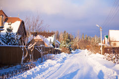 Winter snowy landscape with houses in a small Royalty Free Stock Photo