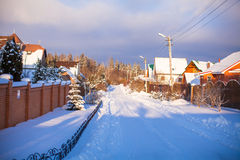 Winter snowy landscape with houses in a small Stock Photography