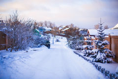 Winter snowy landscape with houses in a small Royalty Free Stock Images