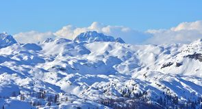 Winter Snowy Landscape Mountain Range. Winter scene on Vogel, Slovenia. Snowy landscape high in the mountains. Panoramic photo of mountain range, a magnificent royalty free stock photography