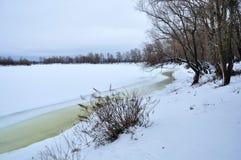 Winter snowy landscape, riverside Royalty Free Stock Image