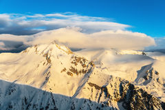 Winter Snowy Mountain Ridge at Sunrise Royalty Free Stock Images