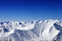 Winter snowy mountains with avalanche slope Royalty Free Stock Photos