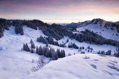 Winter snowy mountains in dusk Stock Photography